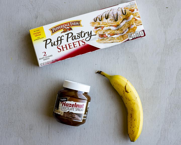 ingredients for nutella puff pastry on a background