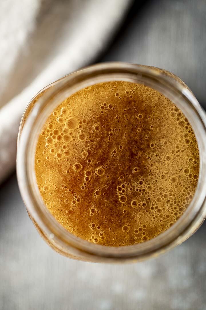 brown liquid in a glass jar