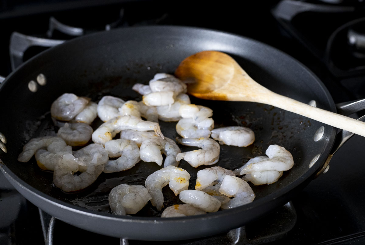 shrimp cooking in a skillet
