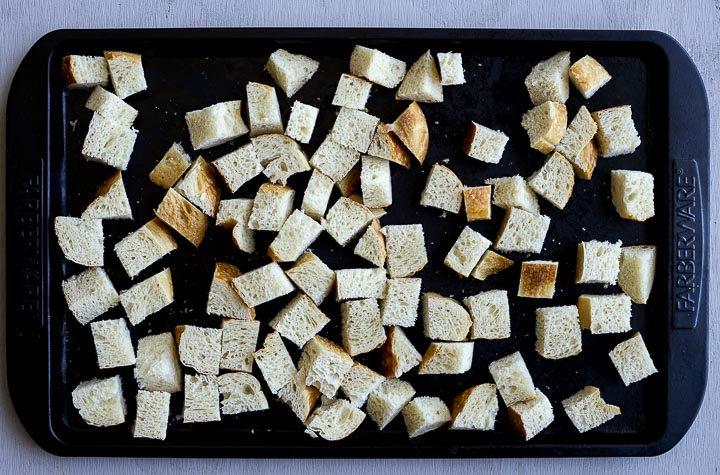 bread cubes on a baking sheet