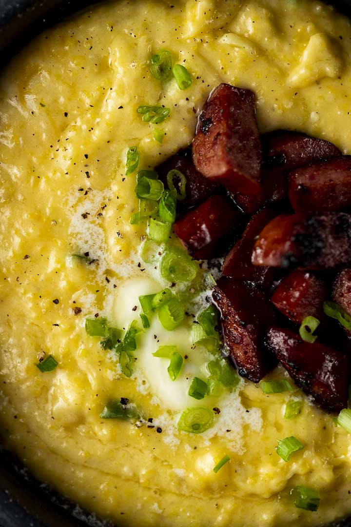 grits topped with browned sausage, butter and green onions