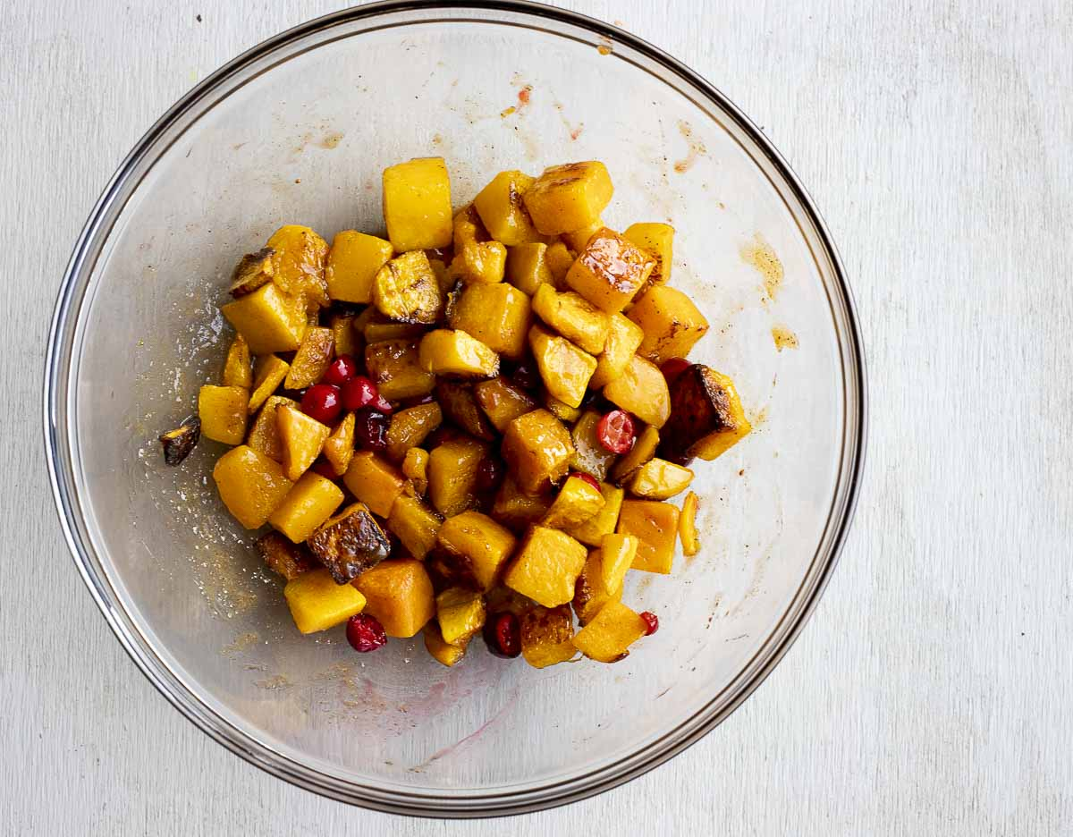 bowl of cubed butternut squash and cranberries