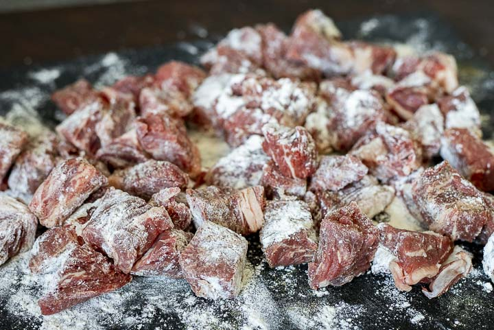 raw beef cubes coated in flour