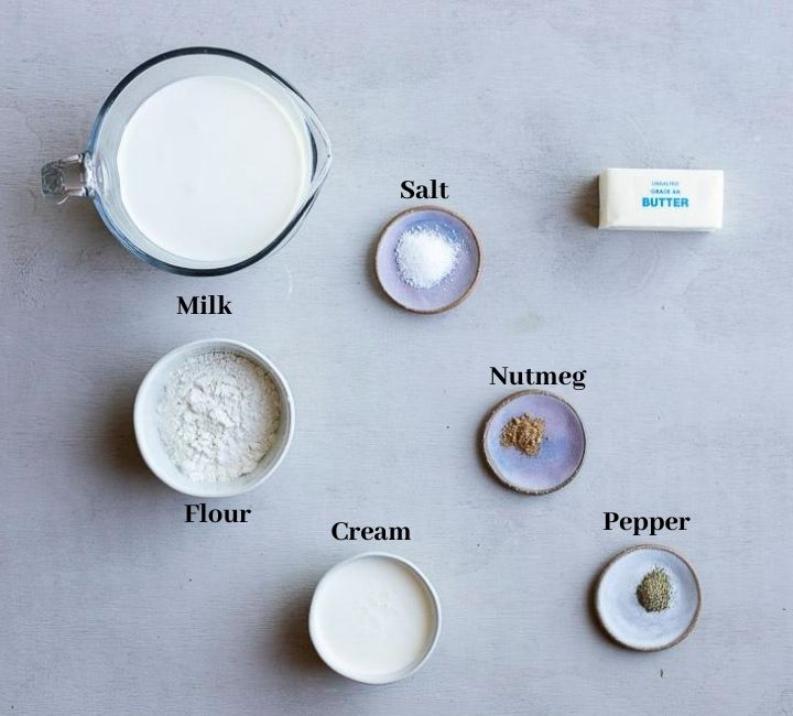 ingredients for bechamel sauce on a surface