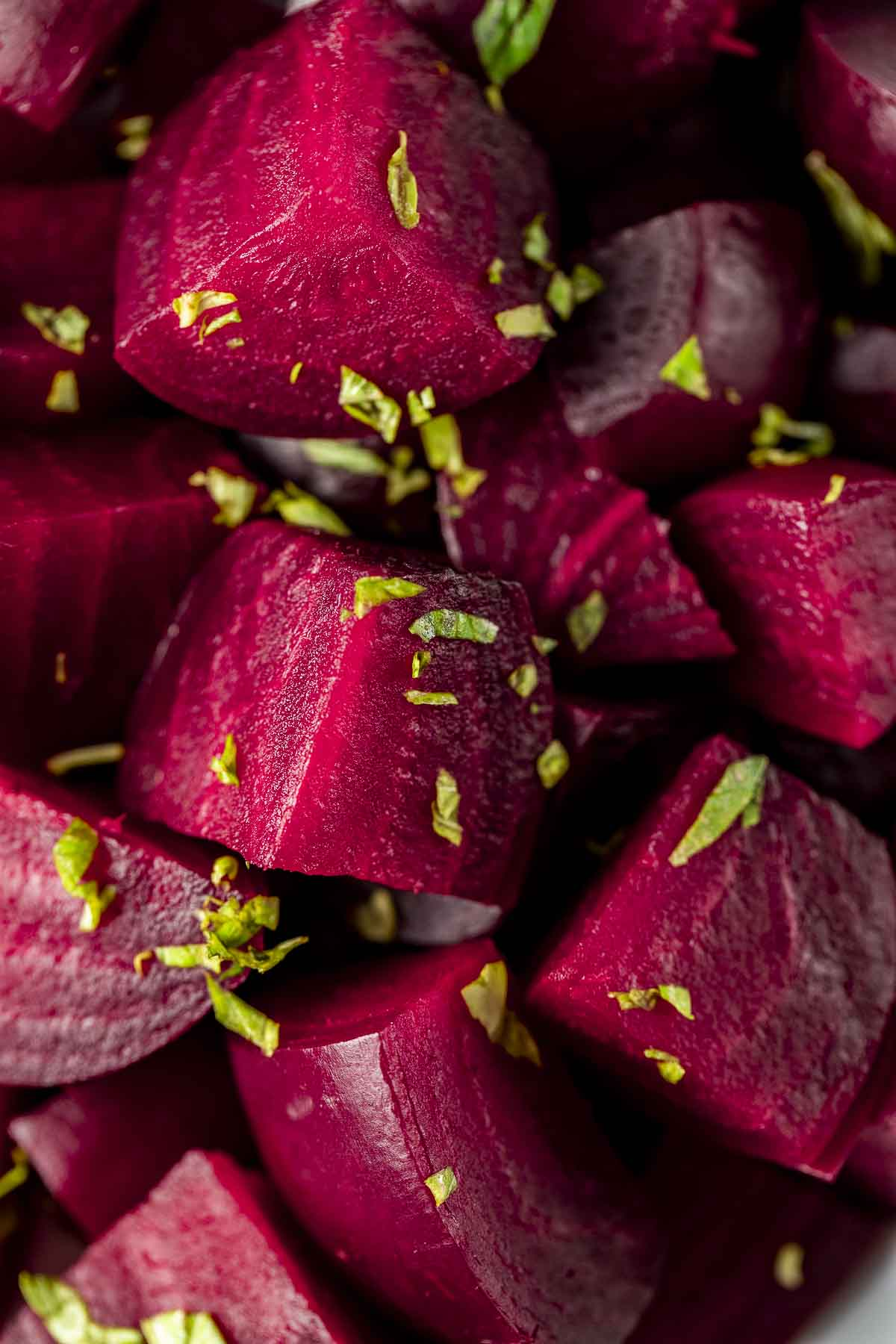 quartered beets garnished with chopped basil