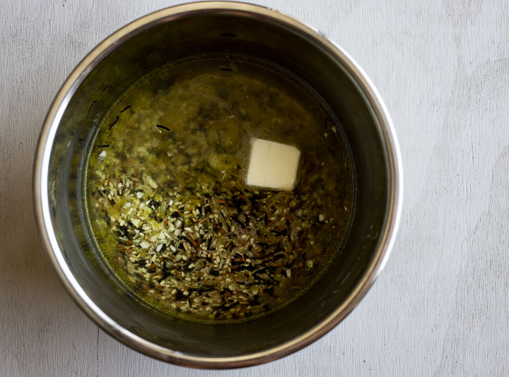 wild rice with butter and broth in a pot