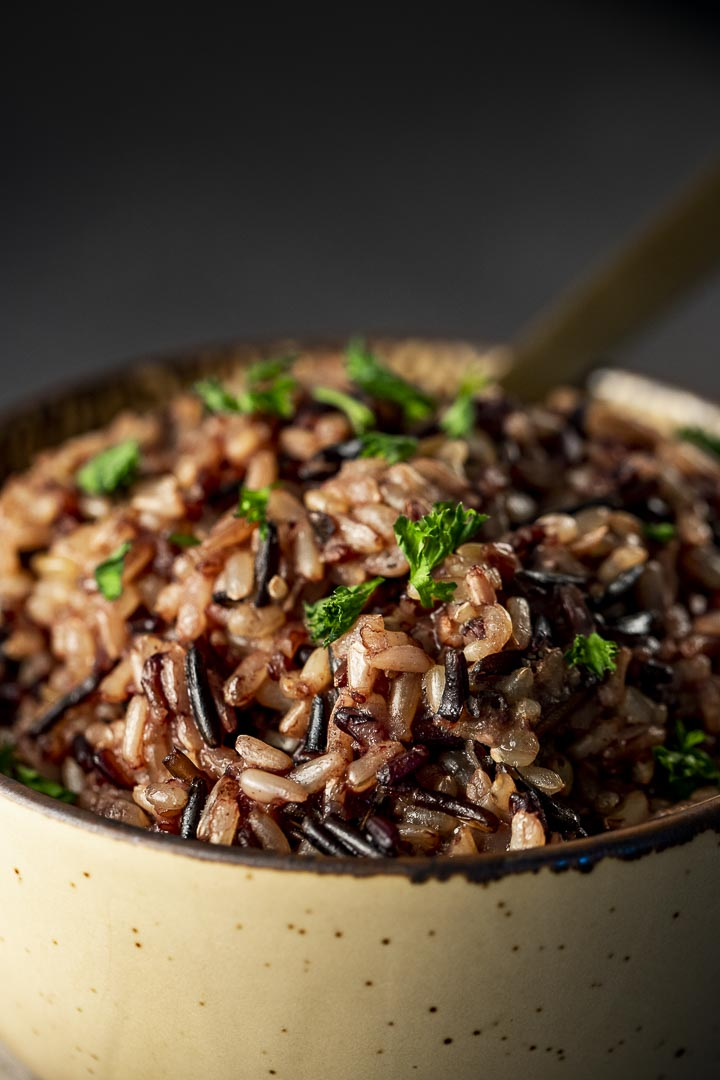 steamed wild rice in a bowl garnished with parsley