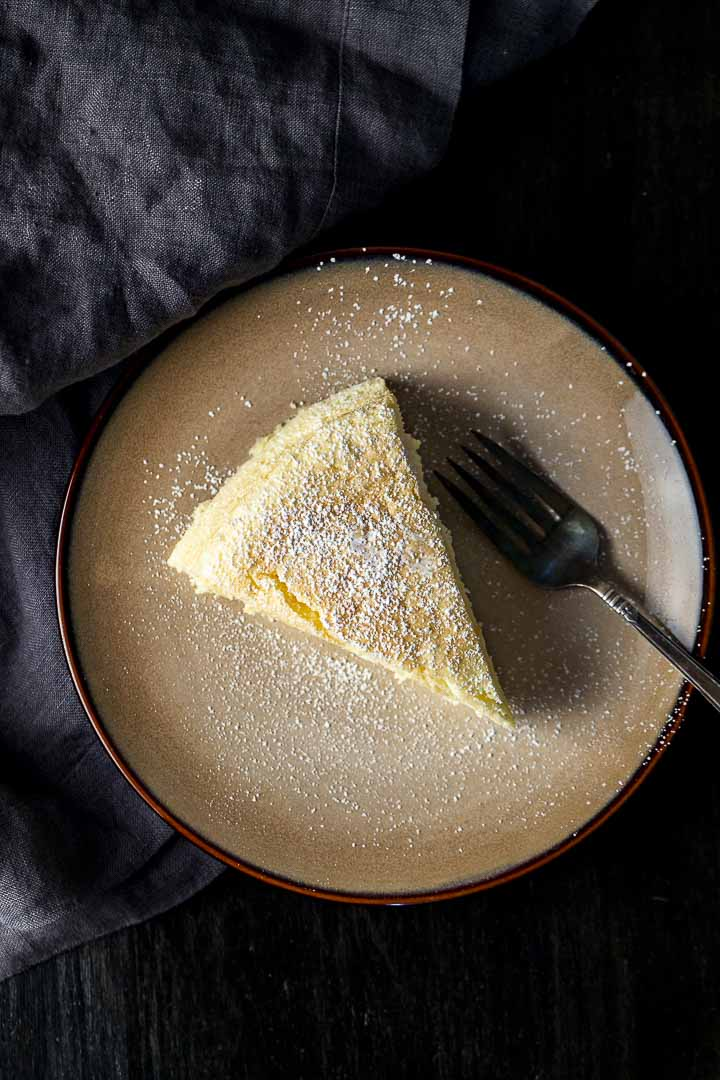 a piece of souffle cheesecake on a plate with a fork