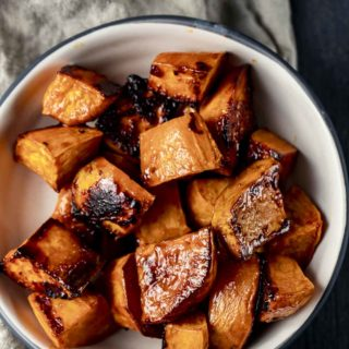 a bowl of caramelized sweet potatoes cut in cubes