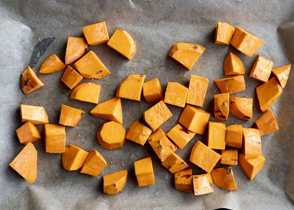 raw cubed sweet potatoes on a baking sheet