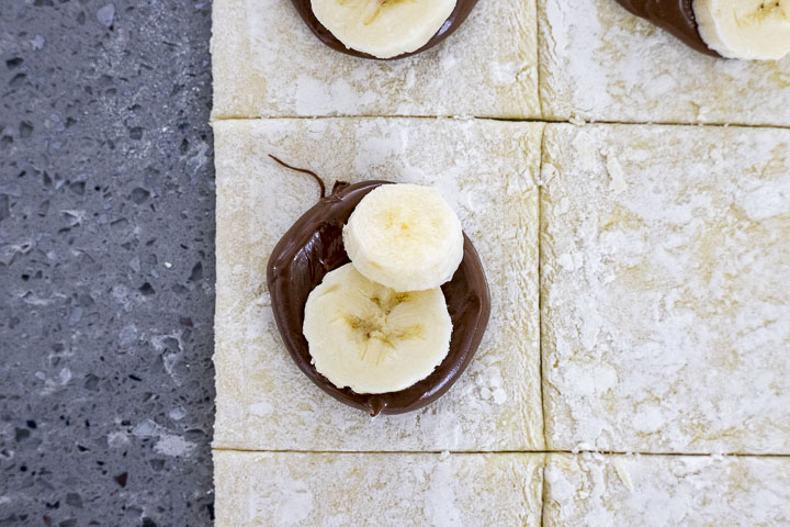 banana and melted nutella (chocolate) on a square piece of dough