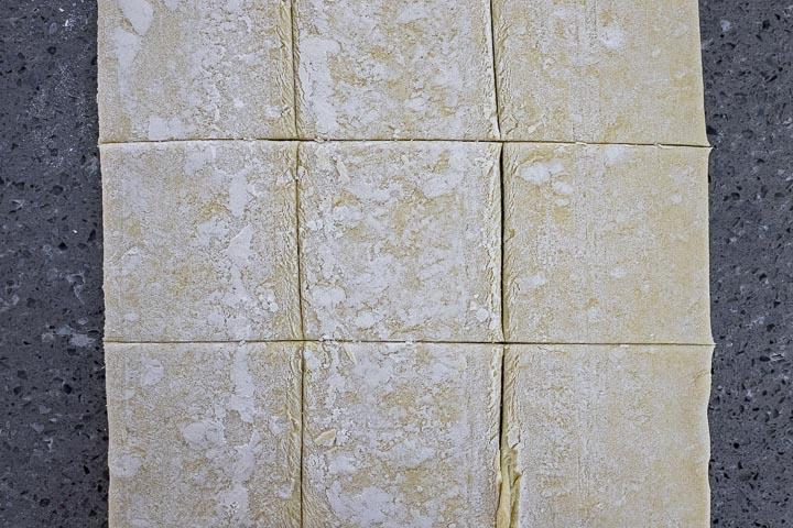 raw dough cut into squares