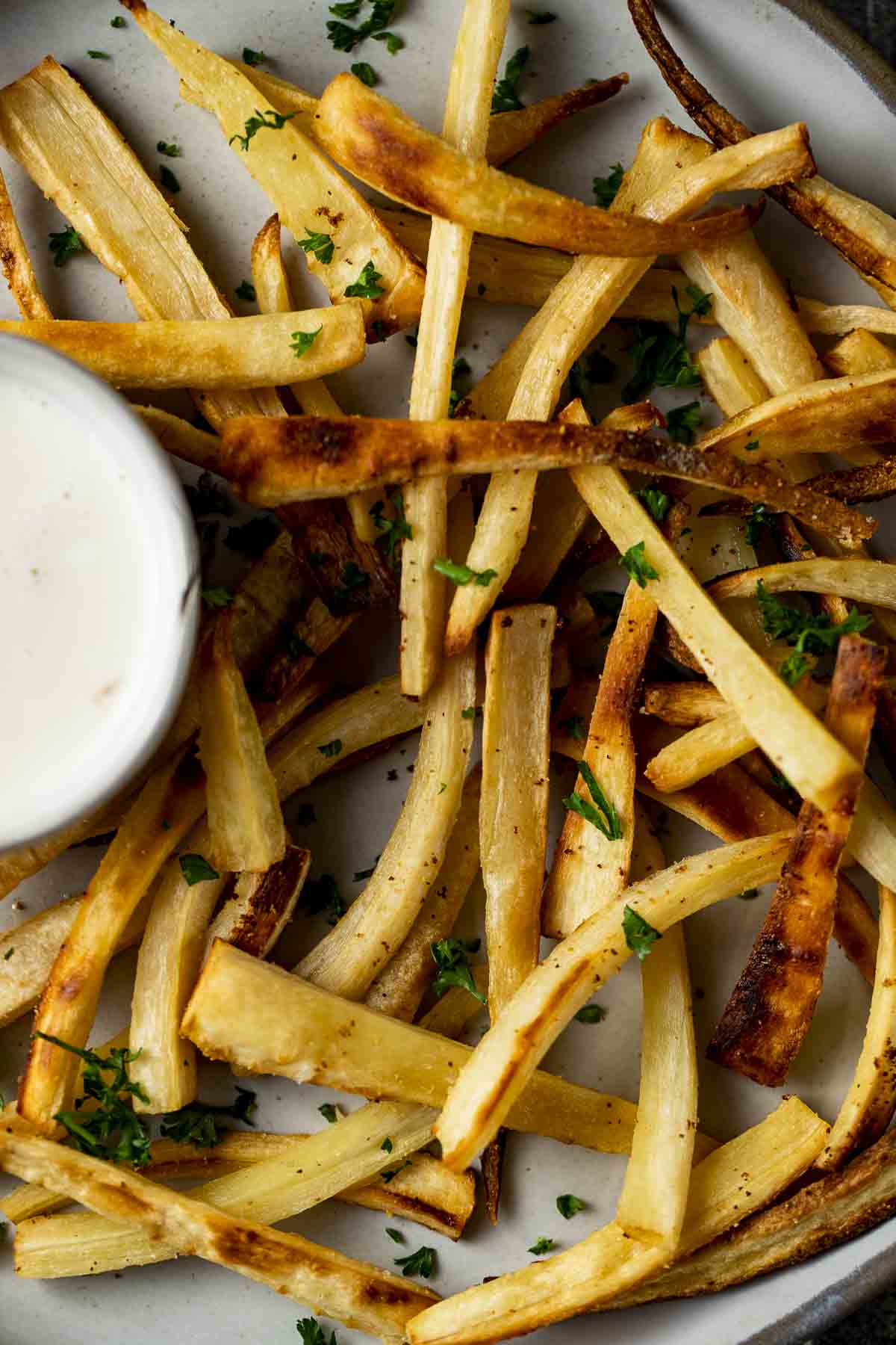 baked french fries (parsnip fries) with yogurt sauce on the side