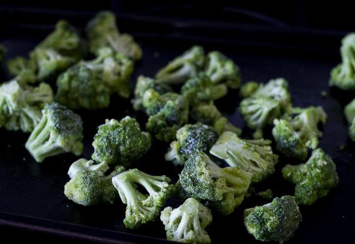 frozen broccoli on a baking sheet