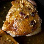 closeup photo of a roasted turkey thigh with glazed skin