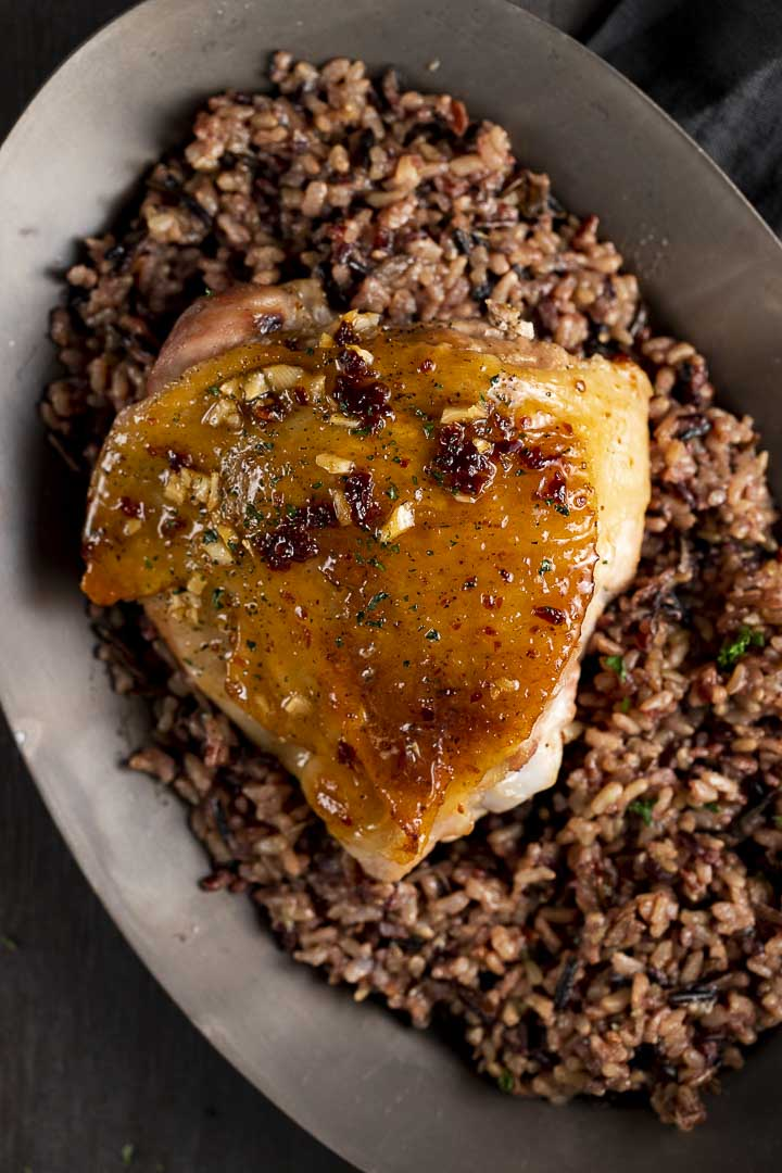 turkey thigh served over wild rice on a plate