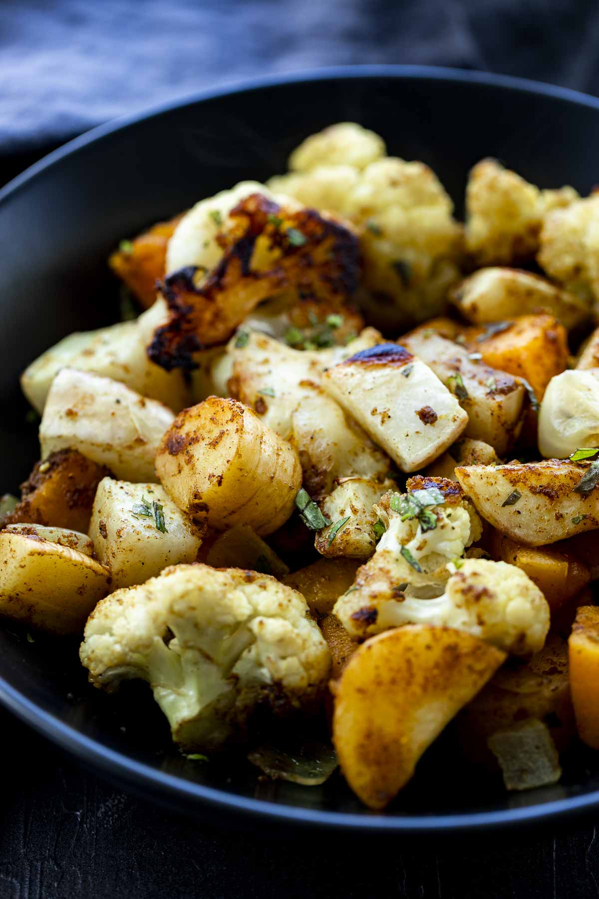 roasted cauliflower, pumpkin and parsnips in a bowl