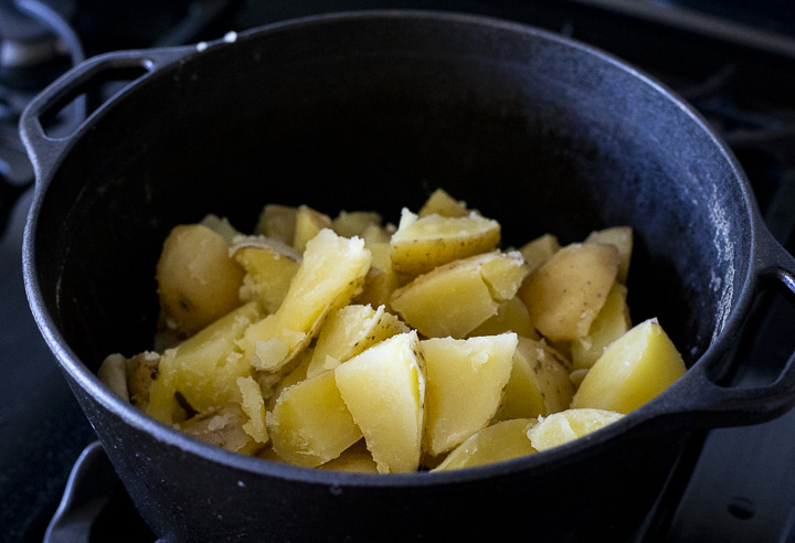 cooked cubed potatoes in a large pot