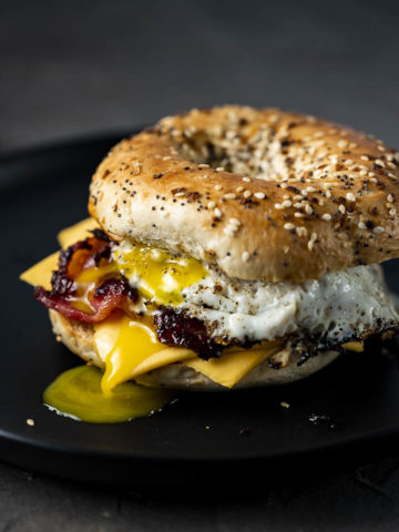 bagel breakfast sandwich with egg and bacon on a plate