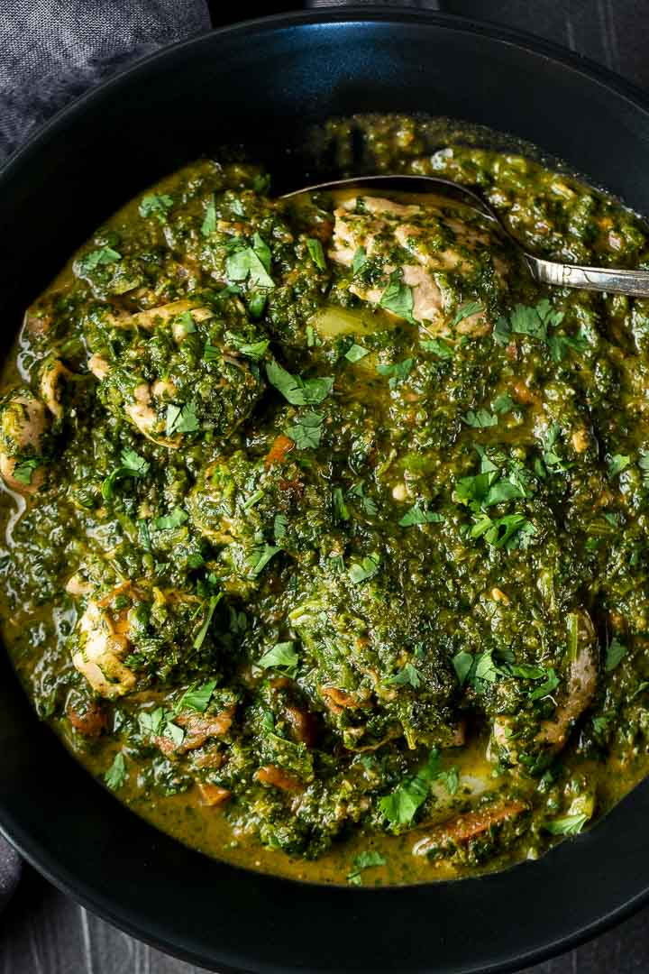 chicken saag curry (spinach curry) in a bowl with a spoon