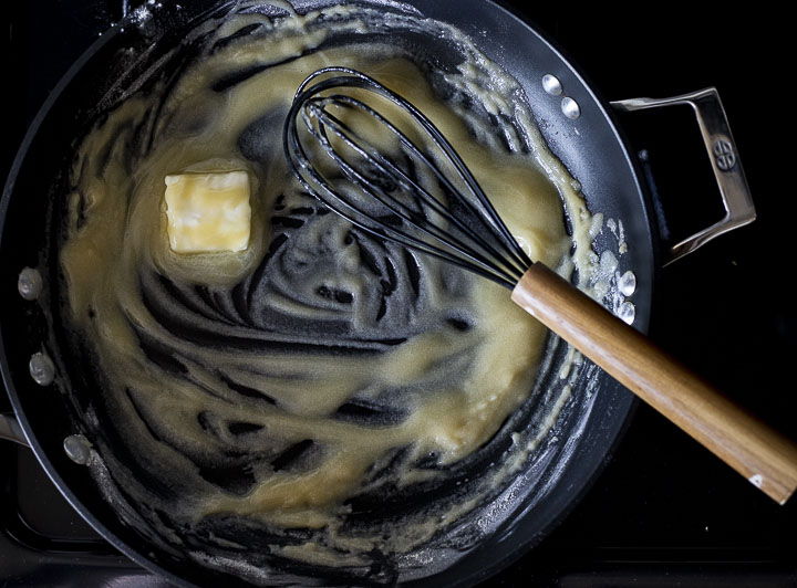 butter and flour cooking in a skillet