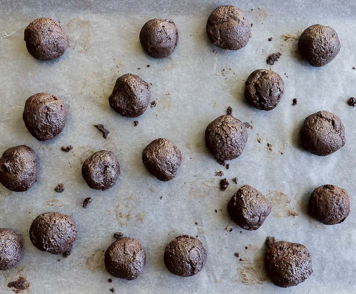 balls of chocolate on a baking sheet