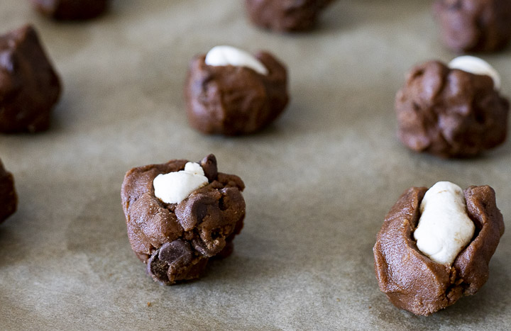 raw cookie dough balls with white marshmallows in the center