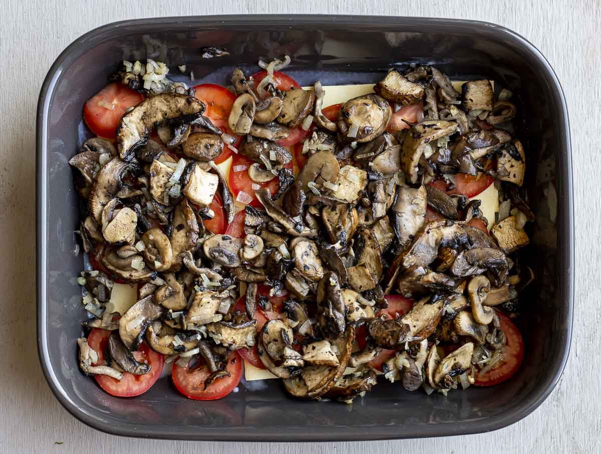 mushroom and tomatoes in a baking dish