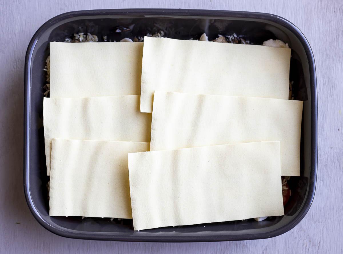 layer o lasagna noodles in a baking dish