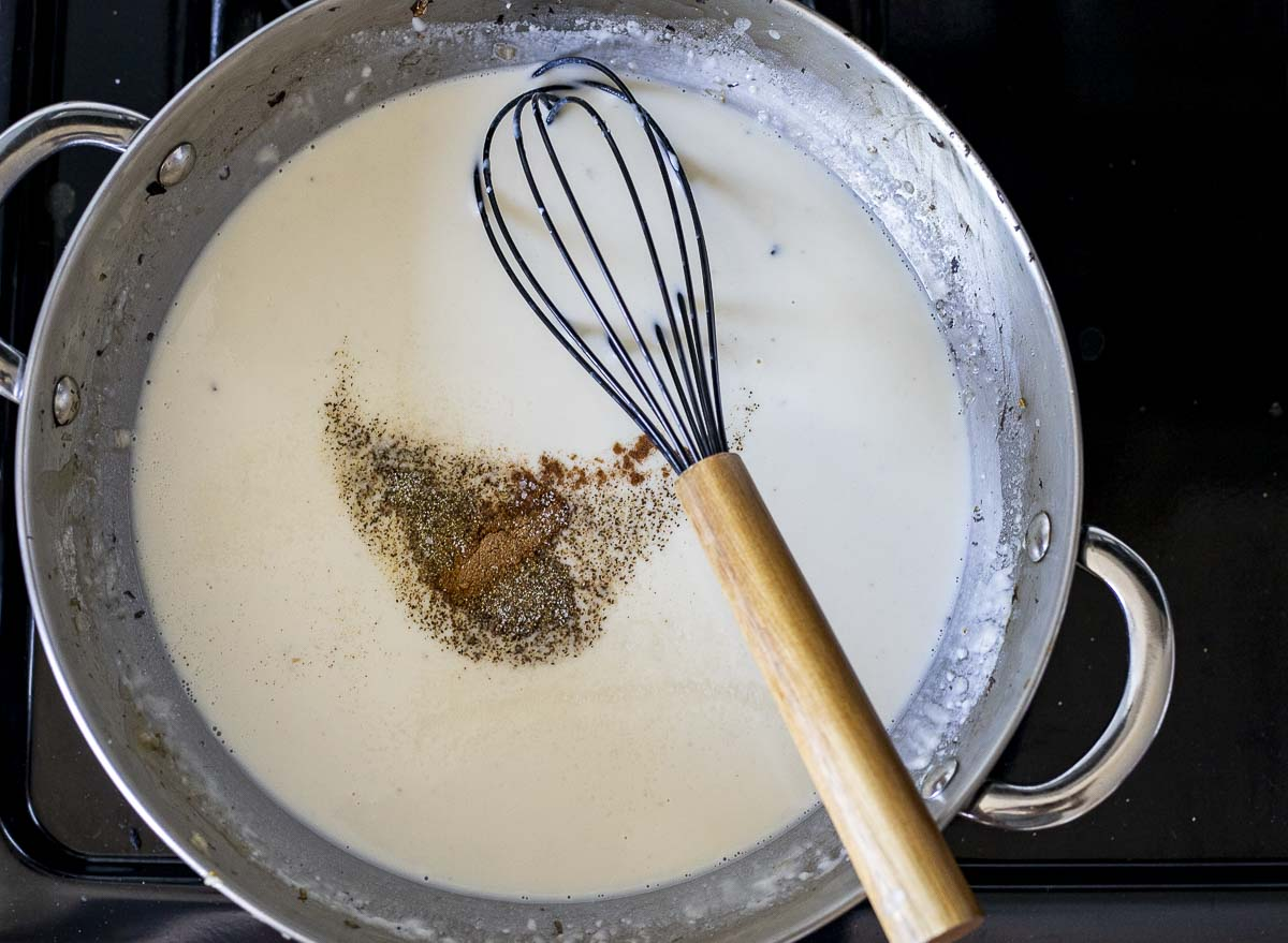white sauce with seasoning in a skillet