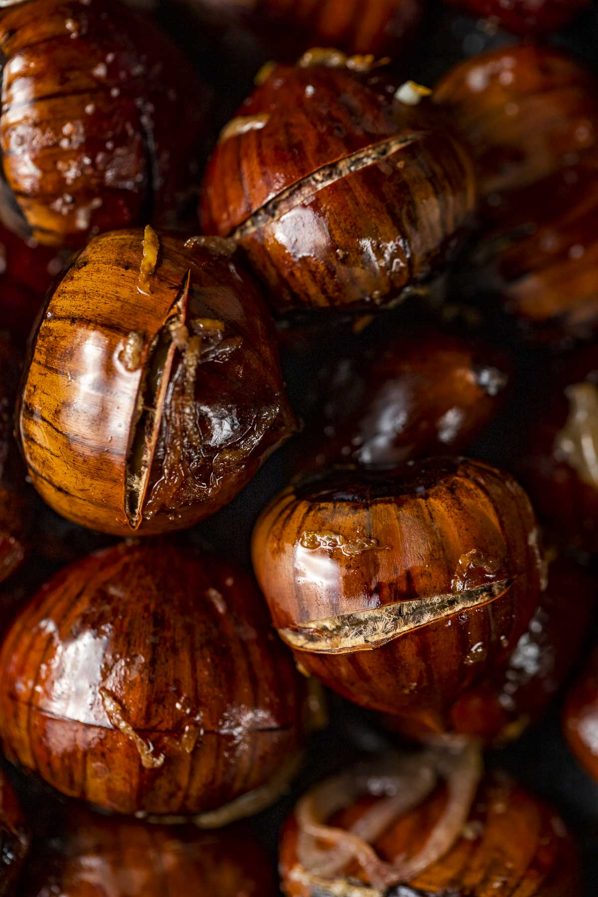 close up photo of several roasted chestnuts