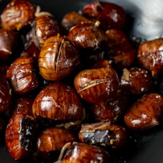 roasted chestnuts in a bowl with shallots and orange zest