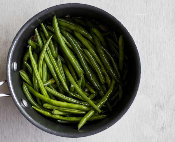 whole green beans in a pot