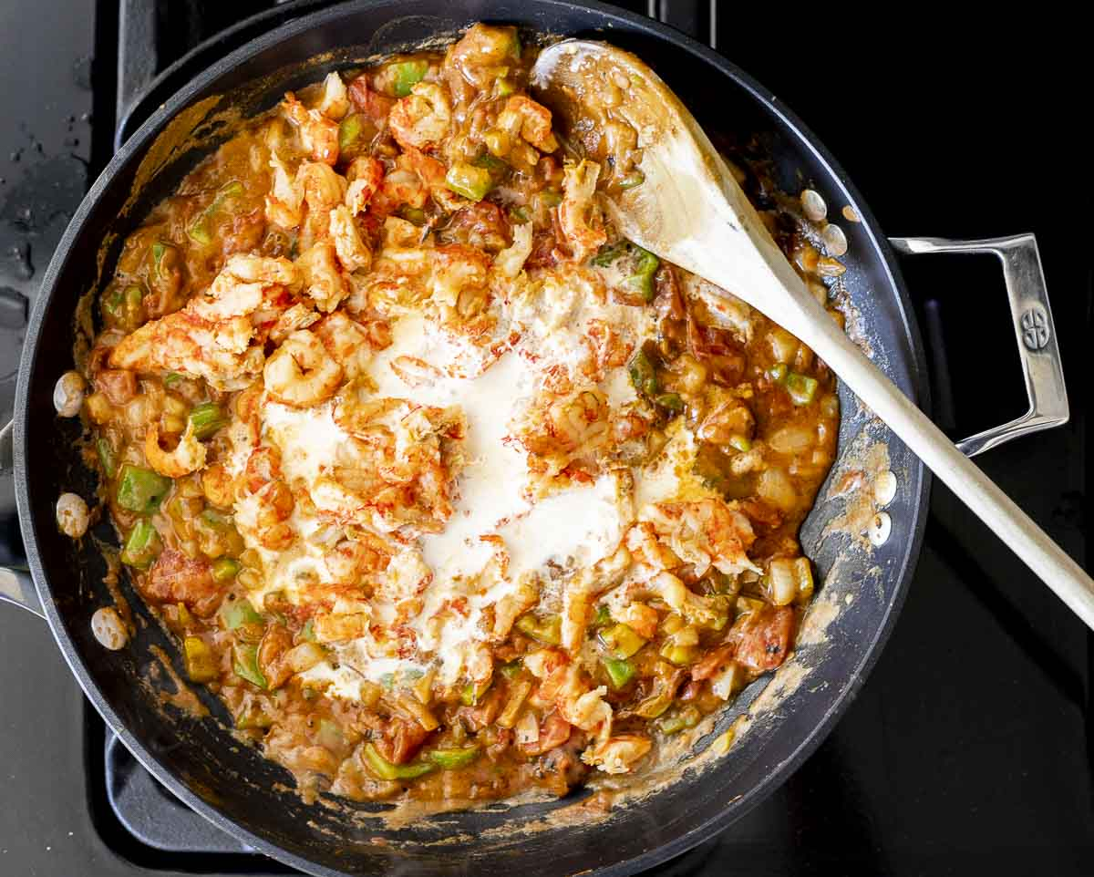vegetable mixture being cooked in a skillet with cream