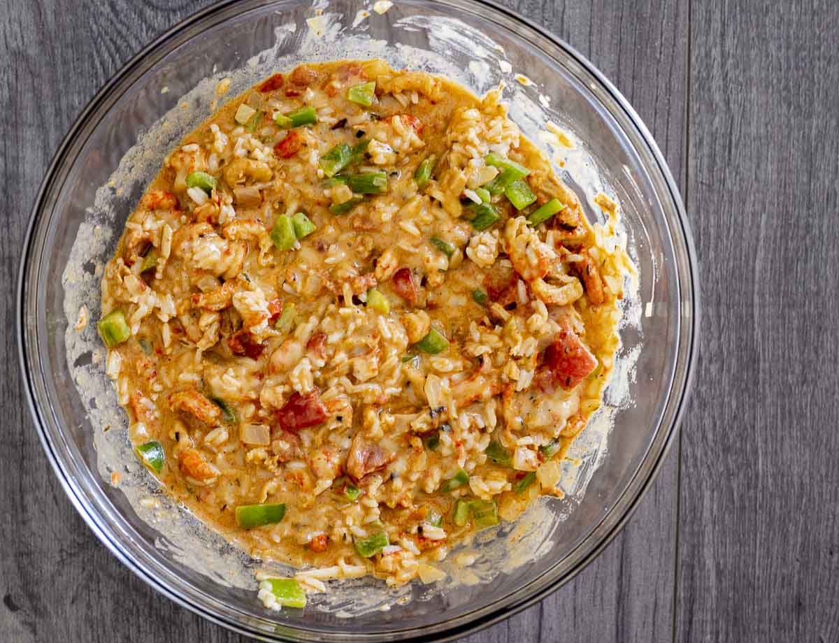crawfish, vegetable and rice mixture in a glass bowl