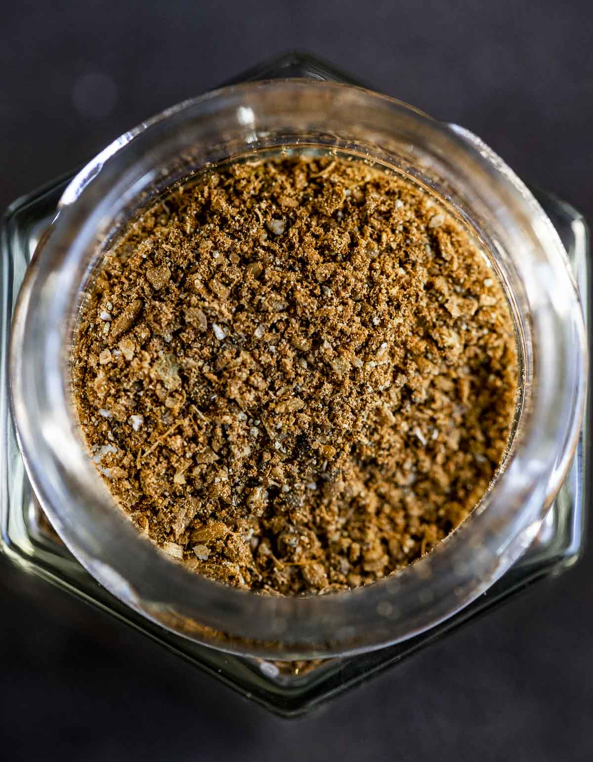 reddish brown ground spices in a jar