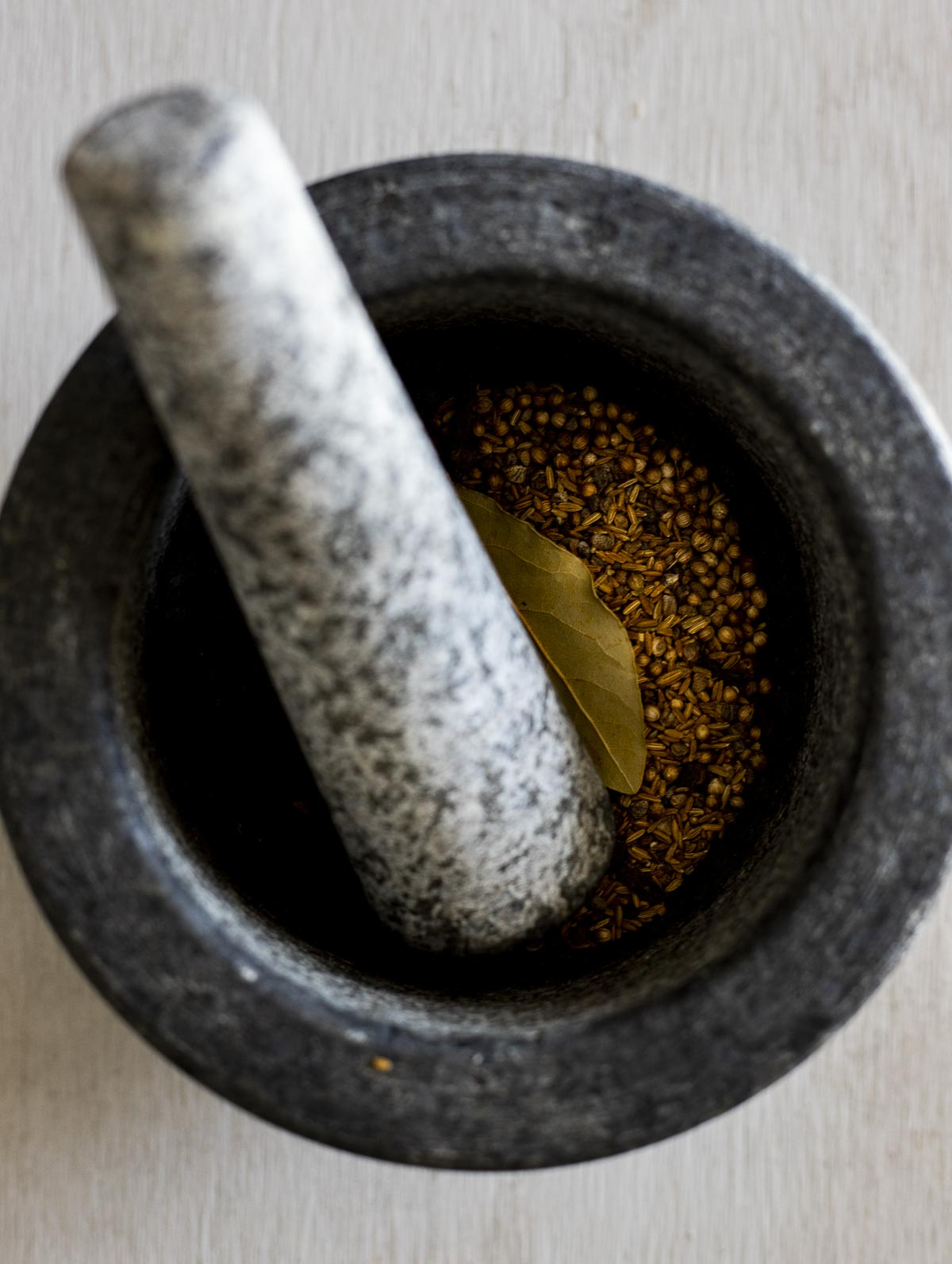 whole spices in a mortar