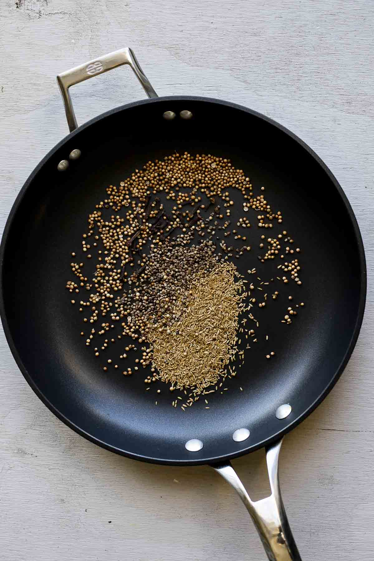 whole spices in a skillet