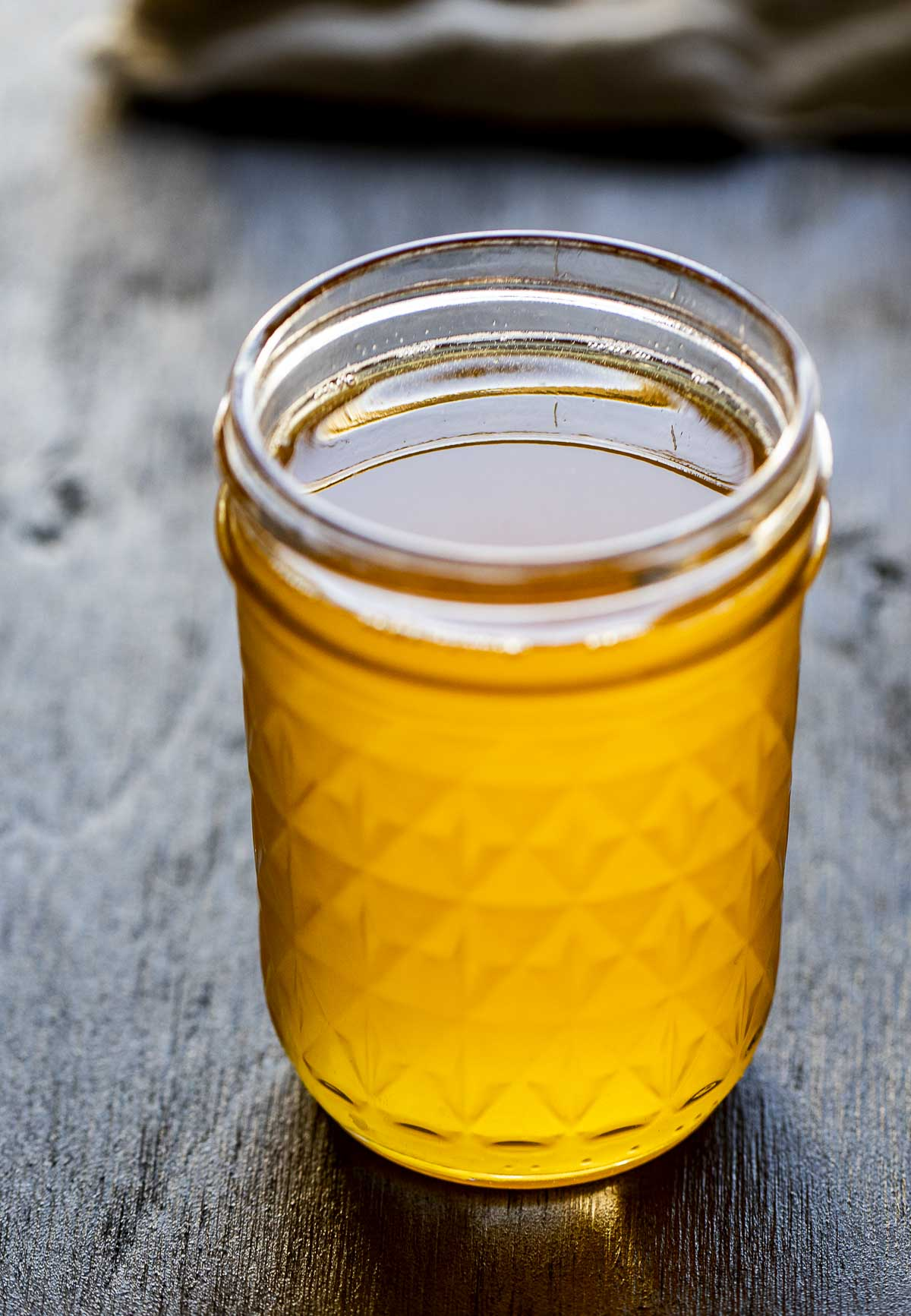 liquid ghee in a glass jar