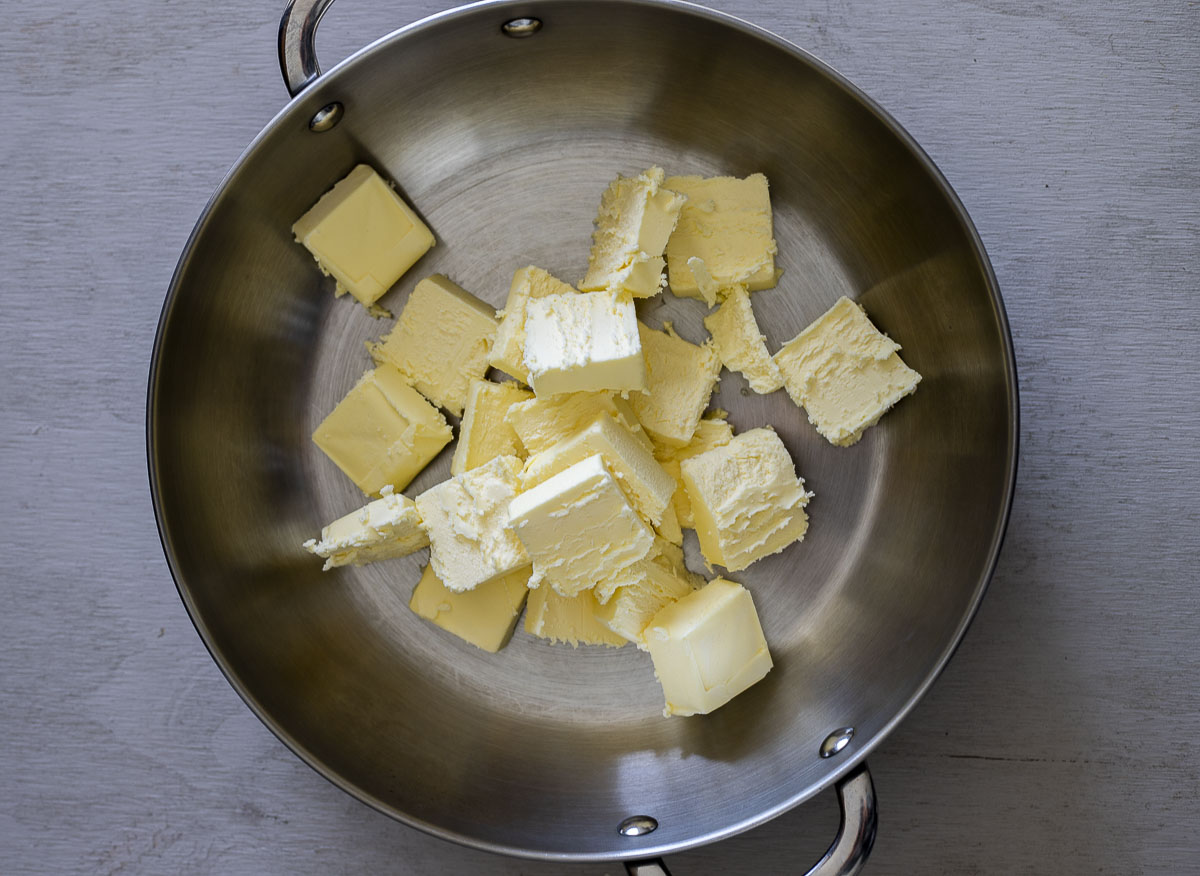 cubed butter in a skillet