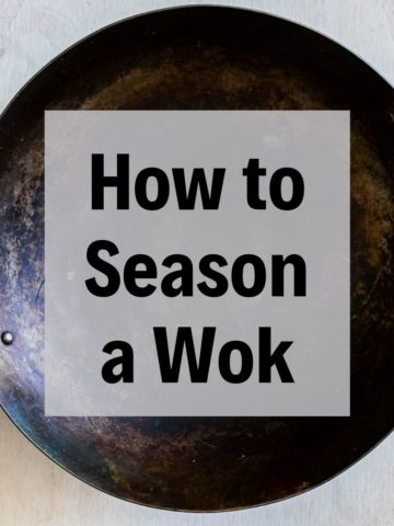 a seasoned wok with text overlay
