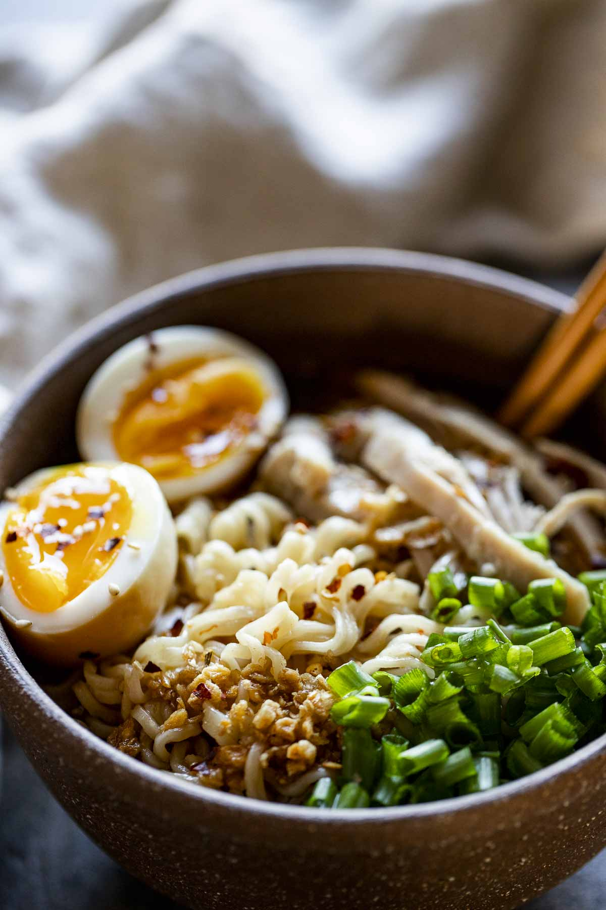 chopsticks in a bowl of ramen noodles