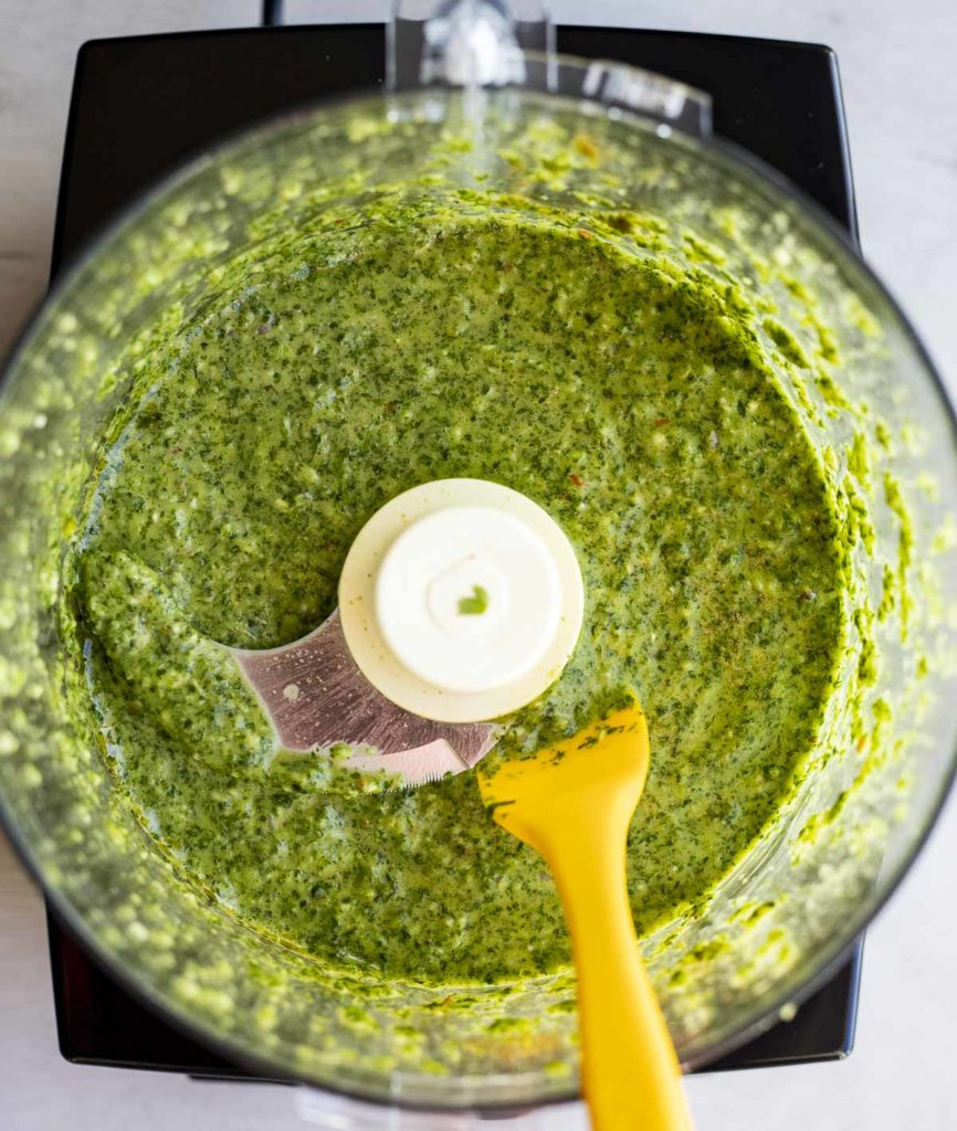 green sauce in a food processor bowl