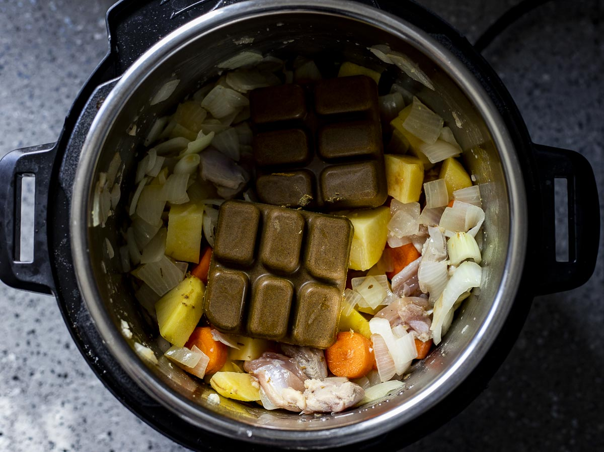 potatoes, onions, carrots in a pot with cubes of brown curry roux