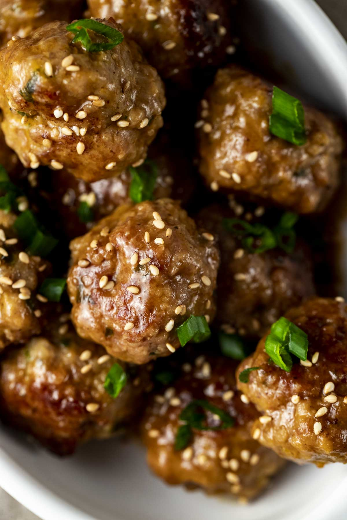 glazed meatballs with sesame seeds and green onions