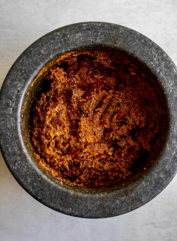orange reddish paste in a mortar