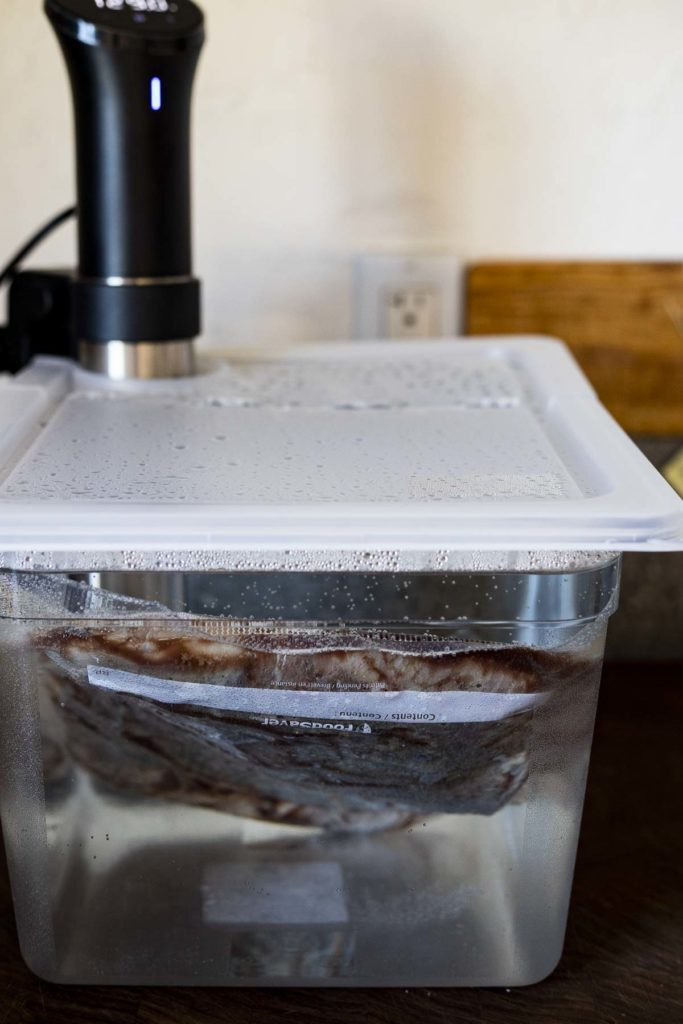 steak in a containerfilled with water and an immersion circulator