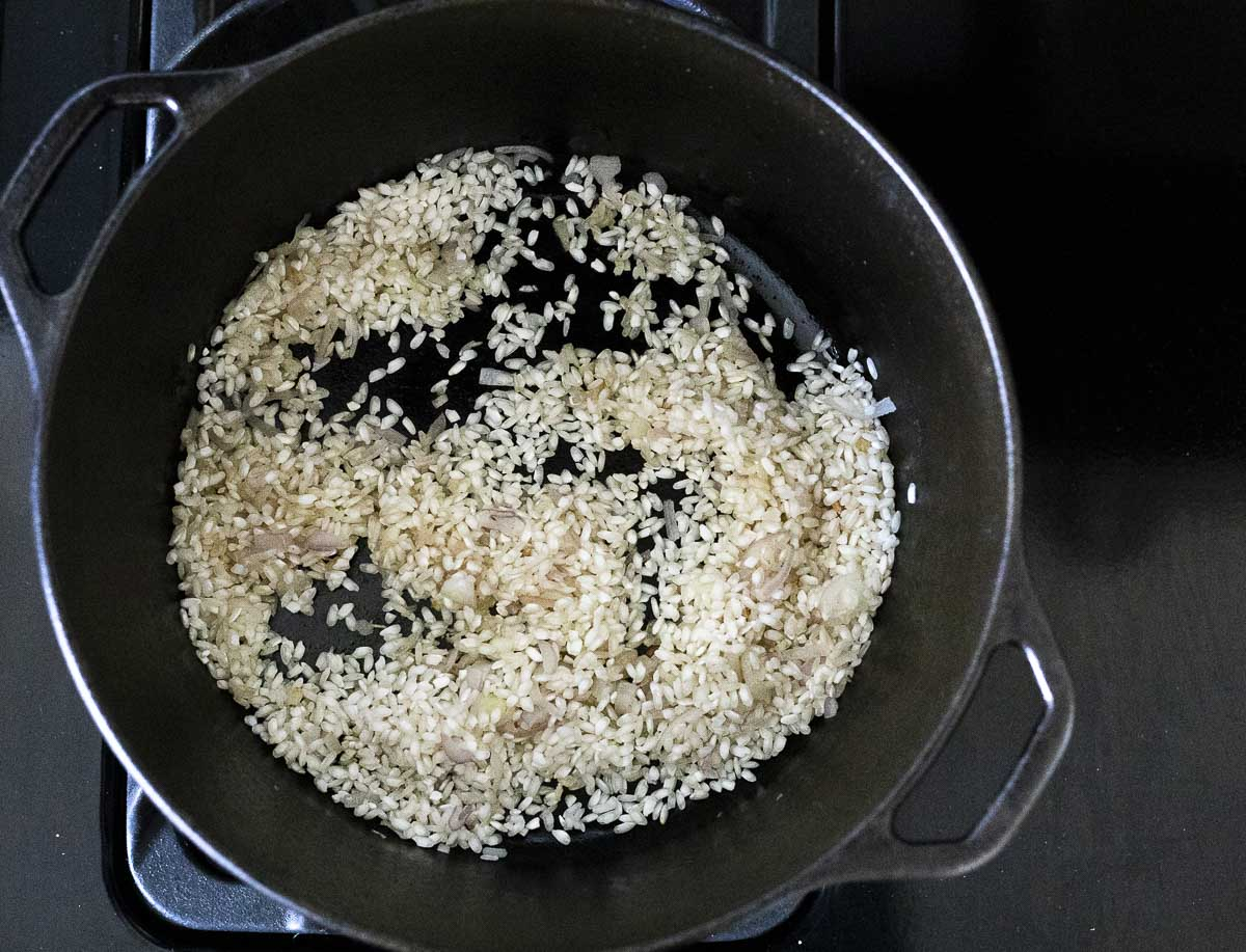 rice toasting in a large pot