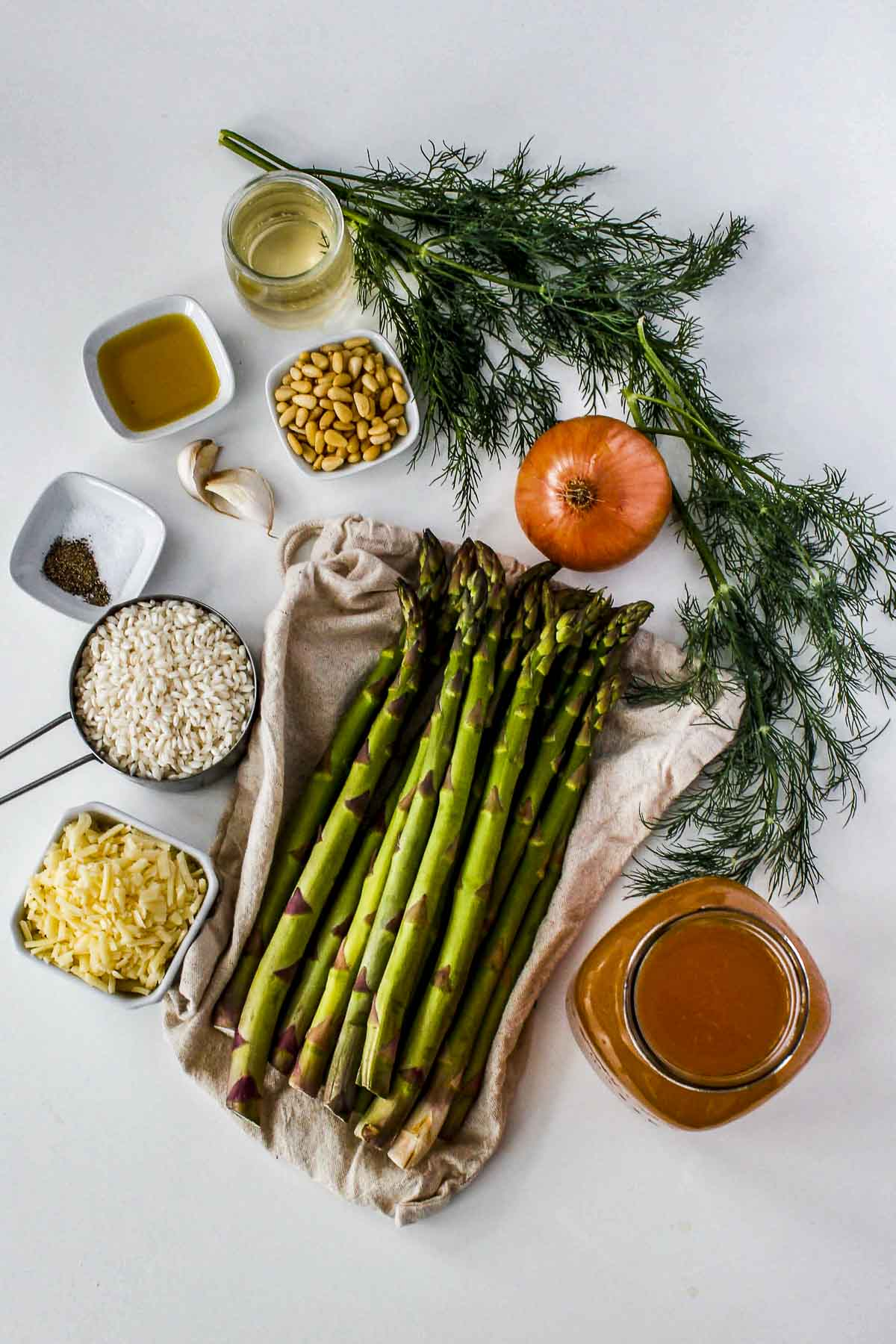 Overhead view of ingredients needed to make asparagus risotto.