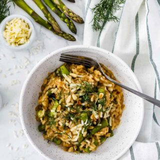 Overhead view of a bowl of risotto with asparagus.